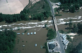 Ochlockonee River - Aerial view of the Ochlockonee River in flood on April 16, 1975 near Bloxham, just southwest of the modern State Highway 20 bridge crossing and the Talquin Dam.