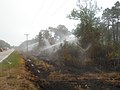 Ongoing Irrigation to Extinguish Fire Next to Highway 264 (5755189664).jpg