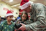 Operation Santa Claus returns to St. Mary's 151205-F-YH552-111.jpg