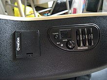 An Ovation Celebrity's on-board electronics (Electronic tuner and preamplifier)
