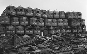 "General Motors streetcar conspiracy - Pacific Electric Railway 'red car' streetcars stacked in Los Angeles awaiting demolition, 1956. Although folklore firmly connects the ""Red Cars""  with these allegations, the PE was never owned by the NCL firms."