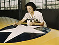Painting the American insignia on airplane wings is a job that Mrs. Irma Lee McElroy1a34899v.jpg