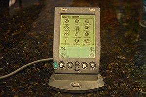 Palm III - A Palm III sitting in its HotSync cradle.