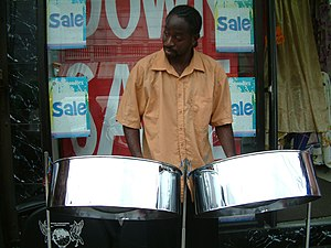 English: A steelpan player on High Street in T...