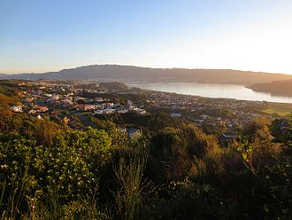 Papakowhai - A view from the north-east: Porirua Harbour to the right, Porirua city centre and Colonial Knob ridge in the background.