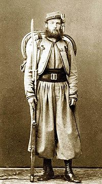 Pontifical Zouave of Major O'Reilley's Papal Brigade, and a veteran of the battles against Garibaldi. Fully armed and equipped with a .71 cal. Model 1842 French Rifle with sword bayonet, and backpack.