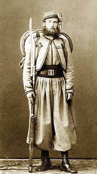Papal Zouaves - Pontifical Zouave of Major O'Reilly's Battalion of St Patrick (1860). Fully armed and equipped with a .71 cal. Model 1842 French Rifle with sword bayonet, and backpack.