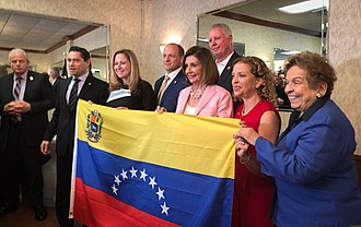 Pelosi and Debbie Wasserman Schultz have supported Venezuelan opposition leader Juan Guaido. Pelosi and US Reps at a Venezuela meeting.jpg