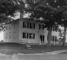 Photograph of a white house.