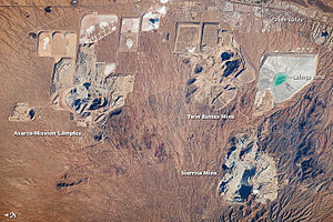 Pima County, Arizona - Astronaut photo of the open-pit copper mines adjacent to Green Valley, 2010. Note that north is to the left.