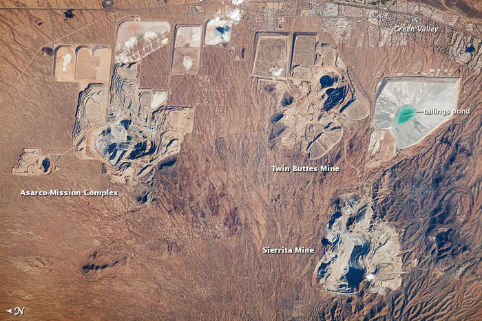 Open-pit copper mines south of Tucson. Note north is to the left. 2010 NASA astronaut photo. Pima Co. Copper mines.jpg