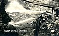 Placer mining showing sluicing with hydraulics, Idaho City, ca 1920 (AL+CA 1541).jpg