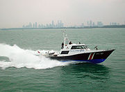 A third generation Patrol Craft of the Police Coast Guard conducting a sea-rescue demonstration off the southeastern coast of Singapore.
