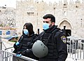 Police officer in Israel with medical masks to protect against coronavirus, March 2020.jpg
