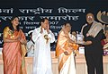 Pratibha Devisingh Patil presenting the Dada Saheb Phalke Award for the year 2005 to the legendary filmmaker Shri Shyam Benegal for outstanding contribution for the growth and development of Indian Cinema at the 53rd.jpg