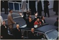 President and Mrs. Nixon waving to the crowd from the Presidential limousine in the Inaugural mototcade - NARA - 194282.tif