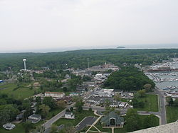 Aerial view looking down into the village's downtown area and DeRiveria Park (wooded area to the right)