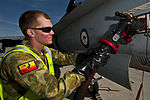 RAAF airman refueling an FA-18 during a Red Flag exercise in the the US.JPG