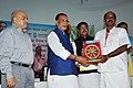 Radha Mohan Singh and the Minister of State for Petroleum and Natural Gas (Independent Charge), Shri Dharmendra Pradhan felicitating a coconut farmer.jpg