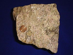 Rare earth ore, shown with a United States pen...