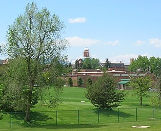 Regis University - A distant view of the athletic fields, Field House, and Main Hall.