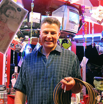 Showman - Robert Edwards, a seventh generation British showman, running his Ring and Blocks stall