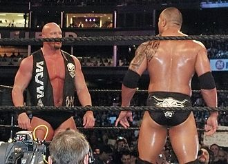 Stone Cold Steve Austin - Austin (left) faces off against The Rock at WrestleMania XIX in Austin's last match