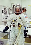 Ron Evans relaxes during pre-launch spacesuit pressure checks.jpg