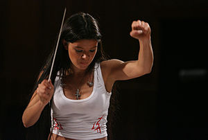 Ruslana - Ruslana is one of the very few pop singers who are capable of conducting a symphonic orchestra, thanks to her higher education in music.