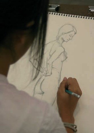 Ryman Arts - A Ryman Arts student drawing a live model in 2007