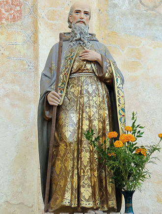 Saint-Avit-Sénieur - A statue of Saint-Avitus, visible inside the church