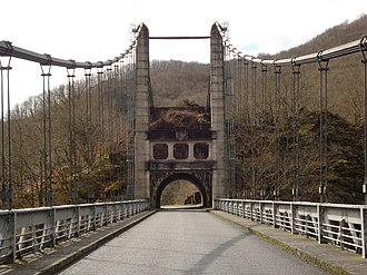 Arches, Cantal - The Saint-Projet bridge over the Dordogne river, in the commune of Arches
