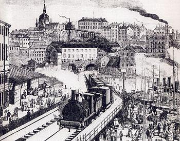 Illustration over sammanbindningsbanen, 1886.   Et pendultog kører nordpå på den såkaldte hvepsetalje ved Riddersholmen, september 2009.