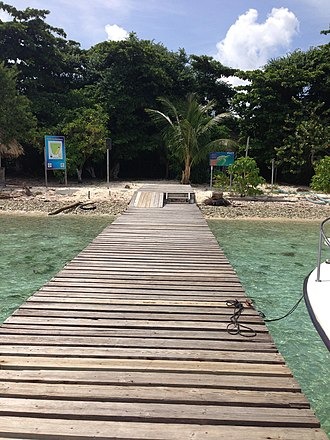 Sapodilla Cayes - Entrance dock on Hunting Caye, to the Sapodilla Cayes Marine Reserve.