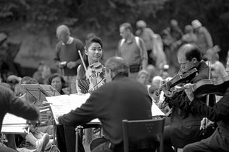Sarah Chang - Chang in Italy at the 2005 Festival I suoni delle Dolomiti, performing outdoors
