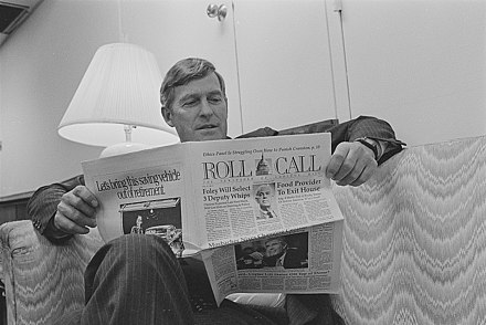 Senator Tim Wirth reading an issue of Roll Call in 1991