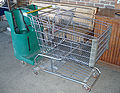 Shopping cart with seating for 3 kids.jpg