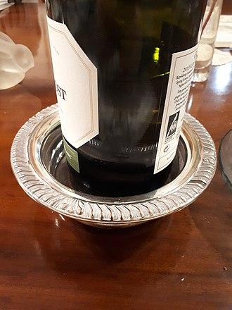 Drink coaster - A silver wine bottle coaster.