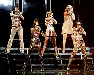 "Spice Up Your Life - The Spice Girls performing ""Spice Up Your Life"" as the opening number of their Return of the Spice Girls tour, at the Air Canada Centre, in Toronto; wearing tight metallic coloured oufits designed by Roberto Cavalli."