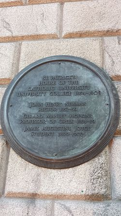 Photo of John Henry Newman, Gerard Manley Hopkins, and James Joyce black plaque