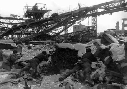 Soviet soldiers in the Red October Factory Stalingrad - ruined city.jpg