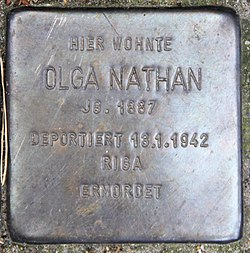 Photo of Olga Nathan brass plaque