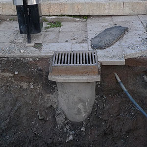 Storm drain - Storm drain with its pipe visible beneath it due to construction work