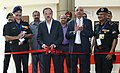 Subhash Ramrao Bhamre inaugurating an exhibition, in which several companies involved in designing and construction of highway tunnels have showcased their exhibits, at a seminar on 'Challenges in Planning, Investigation.jpg