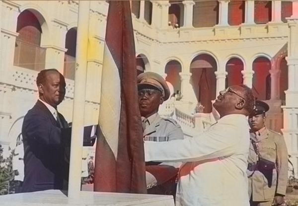 Sudan's flag raised at independence ceremony on 1 January 1956 by the Prime Minister Ismail al-Azhari and in presence of opposition leader Mohamed Ahmed Almahjoub Sudan independence 2.png
