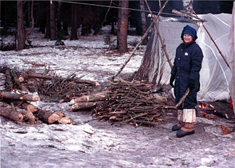 Survivalism - Astronaut Susan Helms gathers firewood during winter survival training.