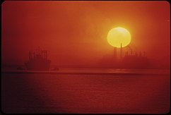 THE SUN RISES OVER CLEVELAND'S SMOG-OBSCURED SKYLINE - NARA - 550304.jpg