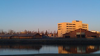 Tanana Chiefs Conference - TCC main campus in downtown Fairbanks, with the Chena River in the foreground.