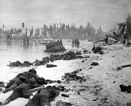 American corpses sprawled on the beach of Tarawa. The Marines secured the island after 76 hours of intense fighting with around 6,000 dead in total. Over 100,000 American military personnel died in the Pacific War. - World War II casualties