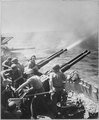Task Force 58 raid on Japan. 40mm guns firing aboard USS HORNET on 16 February 1945, as the carrier's planes were... - NARA - 520746.tif